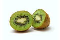 Kiwi. Two halves of kiwi against white background stock images