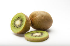 Kiwi. A full, half and slice of a kiwi on a white background Royalty Free Stock Photos