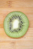 Kiwi. Slice  on a wood background Stock Photo
