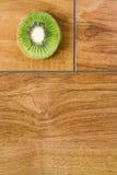 Kiwi. Delicious kiwi on wood Royalty Free Stock Photo