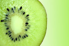 Kiwi. Slice of kiwi on a green background Stock Image