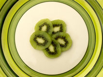 Kiwi. Slices on a green rimmed plate stock image