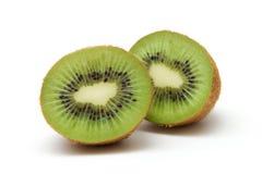 Kiwi 4. Two halves of kiwi against white background stock photography