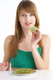 Kiwi. Young woman holds kiwi in her fingers Royalty Free Stock Images