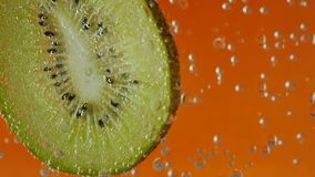 Kiwi in aerated water on background stock video