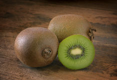 Kiwi on Aged Wood Royalty Free Stock Photos