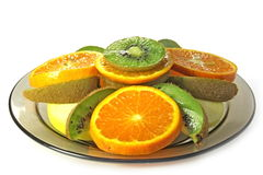 Kiwi, apple and orange. Kiwi, apple and orange is cut in circles Stock Image