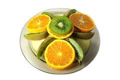 Kiwi, apple and orange. Stock Photos