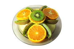 Kiwi, apple and orange. Kiwi, apple and orange is cut in circles Stock Photos