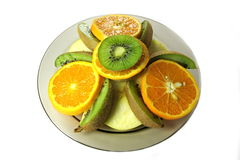 Kiwi, apple and orange. Kiwi, apple and orange is cut in circles Stock Photo