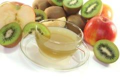 Kiwi and apple tea Stock Photos