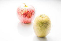 Kiwi and apple on white backgroung Royalty Free Stock Images