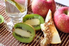 Kiwi, apples and melon Stock Images