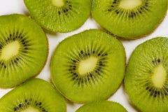 Kiwi background. Kiwi slices on a white background Royalty Free Stock Photo