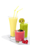 Kiwi, Banana & Berry Smoothies. Tray of smoothie juice drinks with kiwi, banana and berries on a white background royalty free stock image