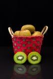 Kiwi on basket with black background Royalty Free Stock Photography
