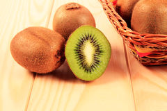 Kiwi in basket Stock Photos