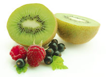 Kiwi with berries Royalty Free Stock Photography