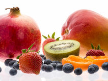 Kiwi, Berries, Apricot, Pomegranate And Mango Royalty Free Stock Photos
