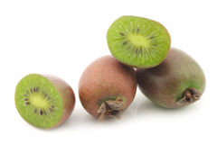 Kiwi berries and a cut one Stock Image