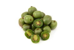 Kiwi berries - whole and sliced in half Royalty Free Stock Photography