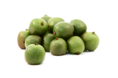 Kiwi berry against heap of green berries Royalty Free Stock Image