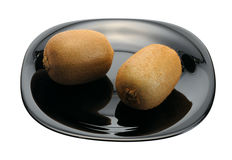 Kiwi on a black plate Royalty Free Stock Image