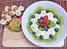 Kiwi,blueberries, strawberries, bananas and passion fruit mixed yogurt Royalty Free Stock Images