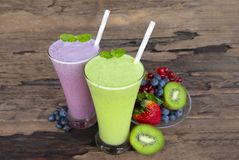 Kiwi and blueberry smoothies purple colorful fruit juice milkshake. Kiwi and blueberry smoothies purple colorful fruit juice milkshake blend beverage healthy stock photos