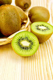 Kiwi on board and in wicker basket Stock Photo