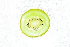 Kiwi with bubbles Stock Image
