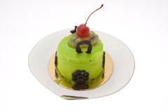 Kiwi cake. With some chocolate and a cherry stock photos
