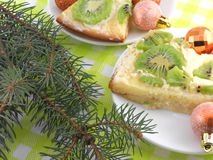 Kiwi cake on plate with christmas balls and new year tree Royalty Free Stock Images