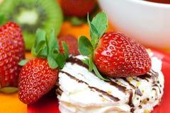 Kiwi,cake and strawberries Stock Image