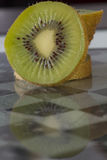Kiwi on chessboard Royalty Free Stock Images