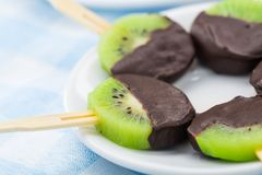 Kiwi with chocolate on a stick Royalty Free Stock Photography