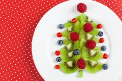 Kiwi Christmas tree - fun food idea for kids party or breakfast royalty free stock images