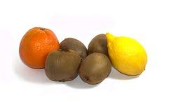 Kiwi, citron och apelsin, sidosikt Royaltyfria Bilder