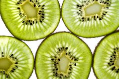 Kiwi Close Up. Close up shot of sliced kiwifruit on white Stock Images