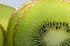 Kiwi. Close up Kiwi fruit with soda water royalty free stock images