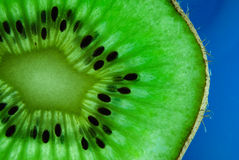 Kiwi close up shot. Sliced kiwi macro or close up shot at side surrounded with black seed Stock Images