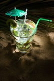Kiwi cocktail on the sand Royalty Free Stock Image