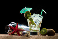Kiwi cocktail on the sand Stock Images