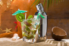 Kiwi cocktail on the sand Royalty Free Stock Photos