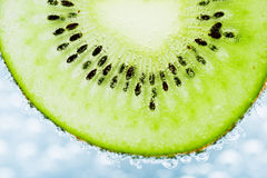 Kiwi covered with bubbles Royalty Free Stock Photo