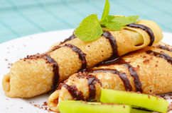 Kiwi crepes with chocolate sauce Royalty Free Stock Photo