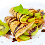 Kiwi crepes with chocolate sauce Royalty Free Stock Image