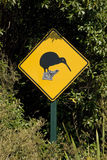 Kiwi crossing. Road sign; wandering kiwi crossing stock photography