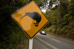 Kiwi crossing road sign. With a car on a background. Northland, New Zealand royalty free stock photos