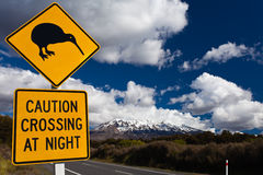 Kiwi Crossing road sign and volcano Ruapehu, NZ Royalty Free Stock Images
